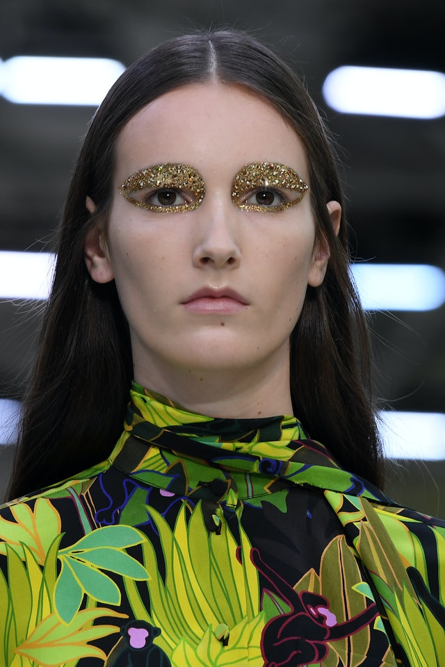 Model wearing Pat McGrath Lab's Obsessive Opulence collection on the runway at Valentino