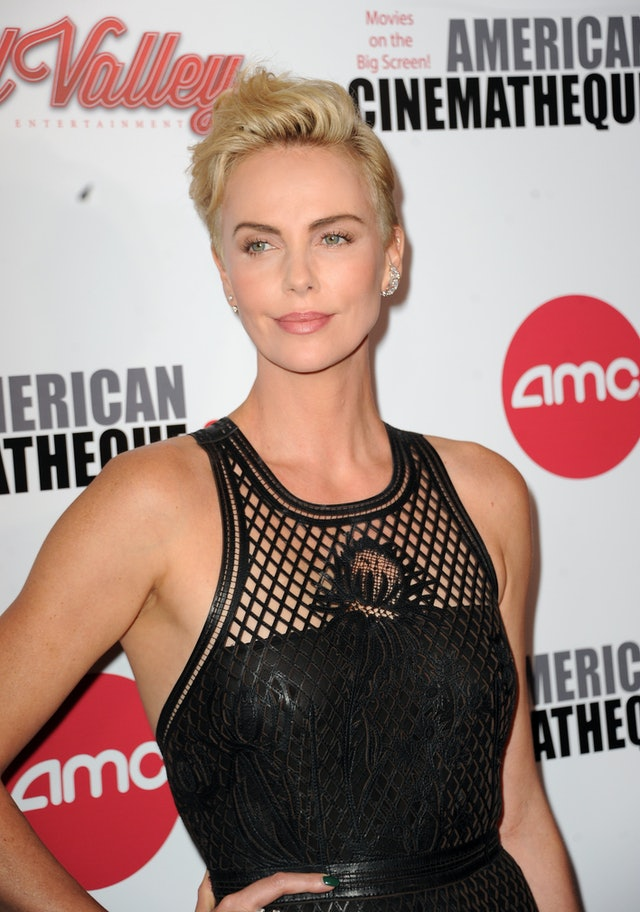 Charlize Theron's blonde pixie haircut with black Dior gown