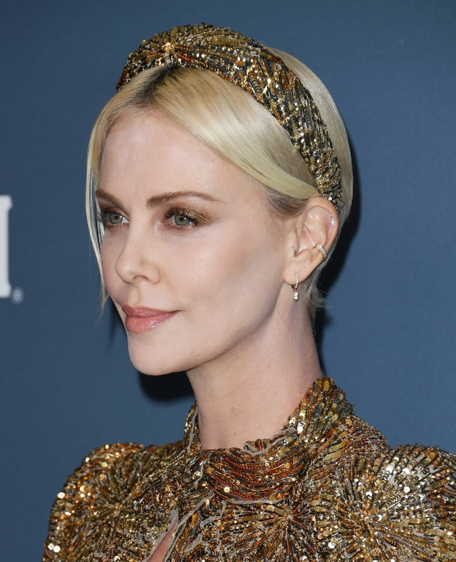 Charlize Theron's Headband At The Costume Designers Guild Awards Was Custom-Made To Match Her Gown