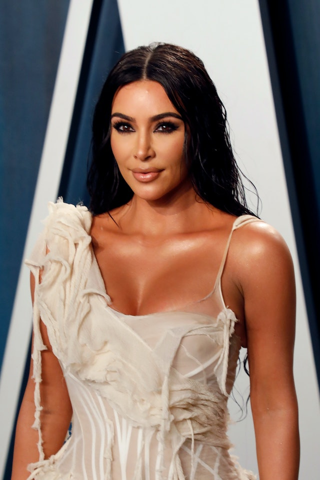 Kim Kardashian's signature beauty look includes smokey eyes and a nude lip