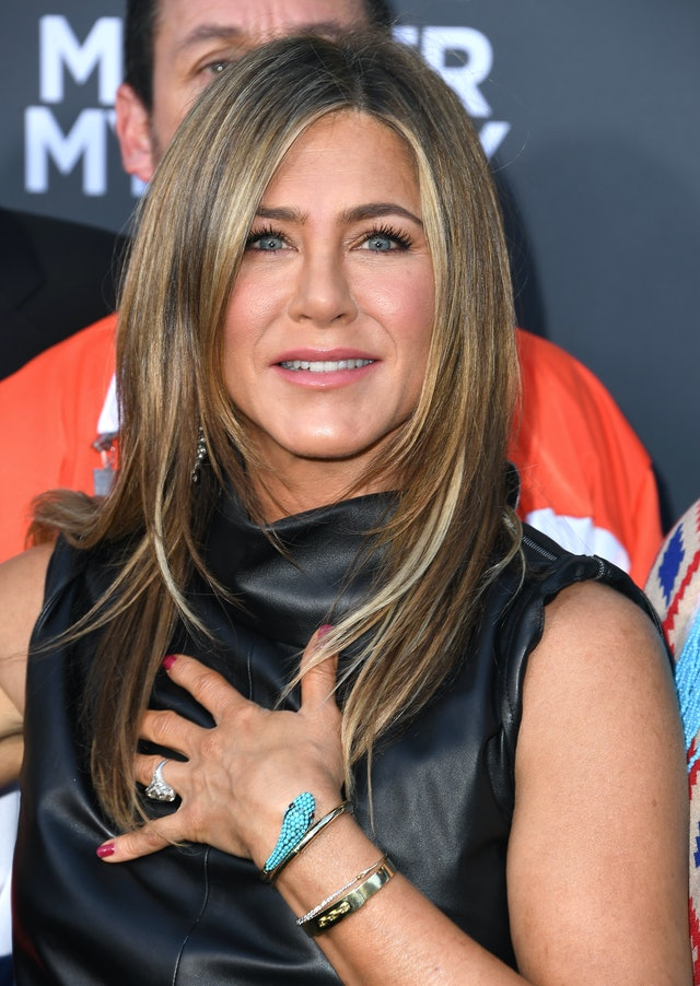 Jennifer Aniston is also partial to a classic red nail polish