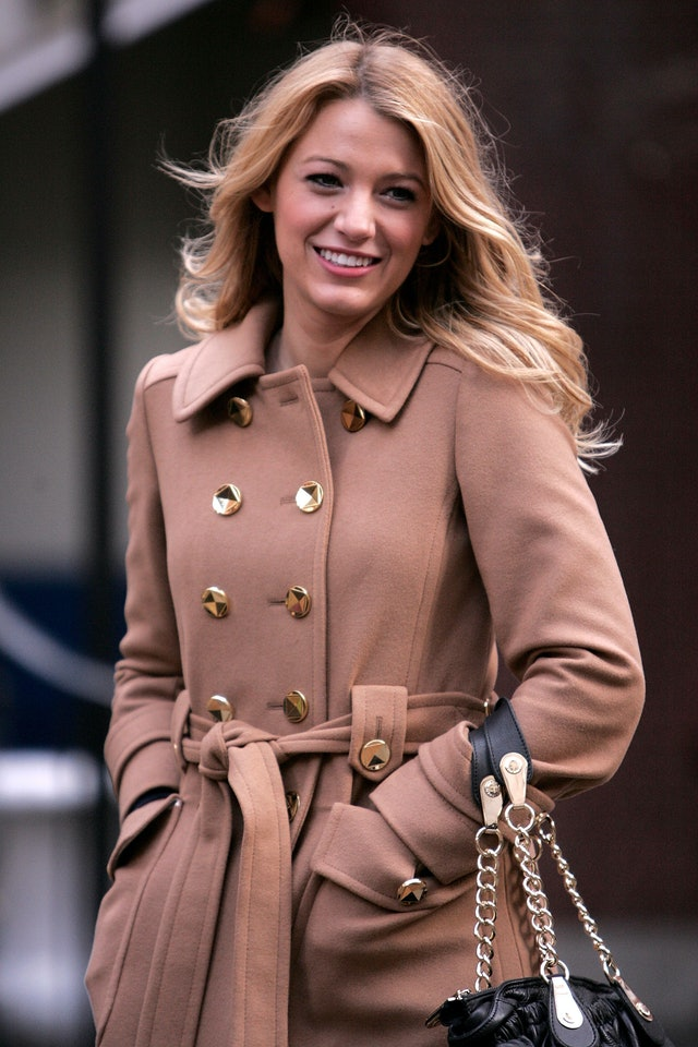 Blake Lively in a camel-colored peacoat with soft curls in her hair