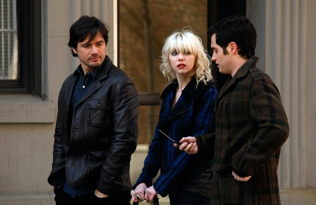 Taylor Momsen with bangs and a fringe hair cut in a blue plaid jacket.