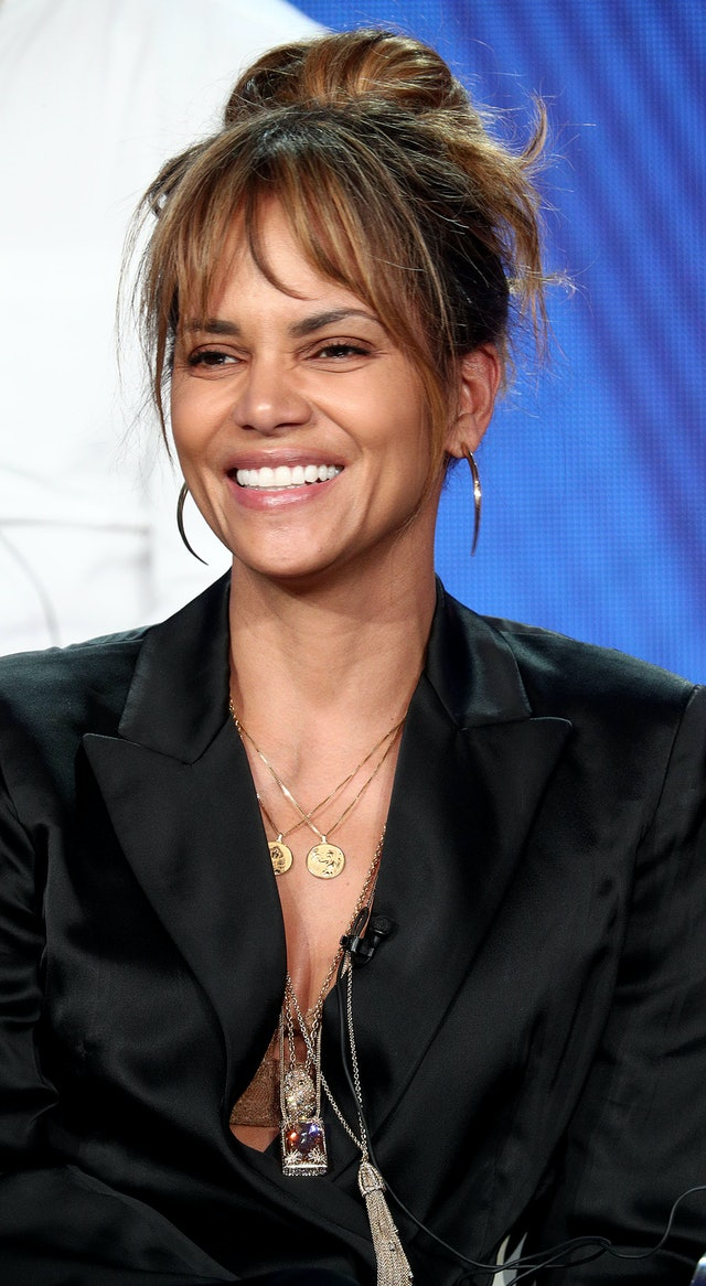 Halle Berry's '60s-inspired bun is brought up to date with her chic statement jewelry