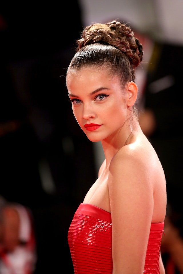 Barbara Palvin wore a braided bun and red dress on the red carpet