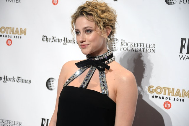 Lili Reinhart wore a black bedazzled dress with her curly bun on the Gotham Awards Red Carpet