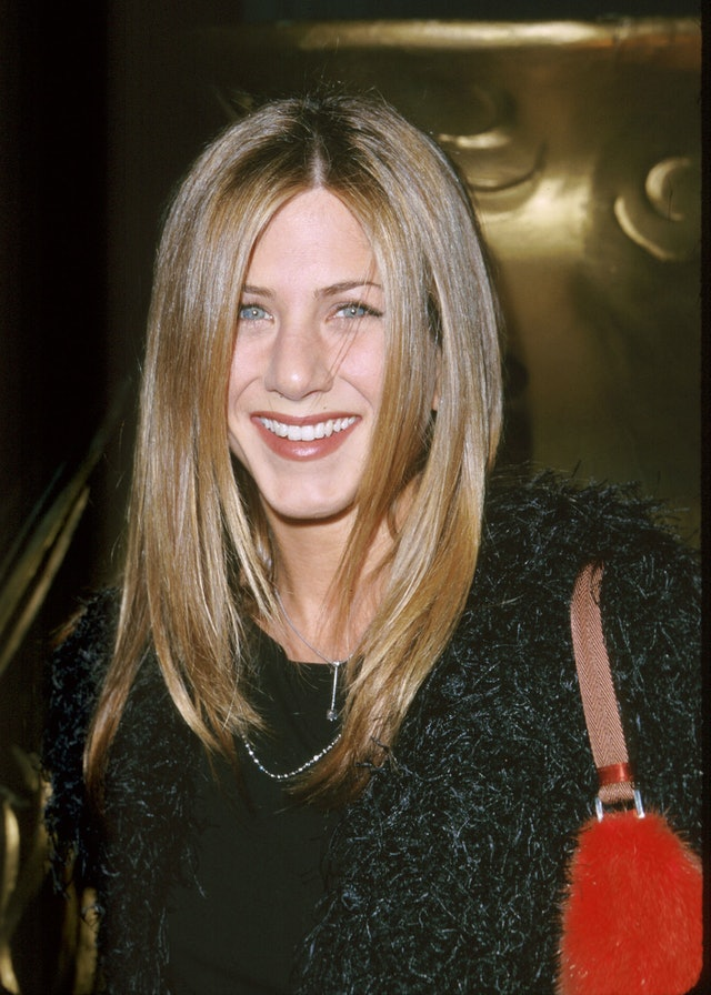 A red lip and understated eye makeup were one of Aniston's most iconic looks.