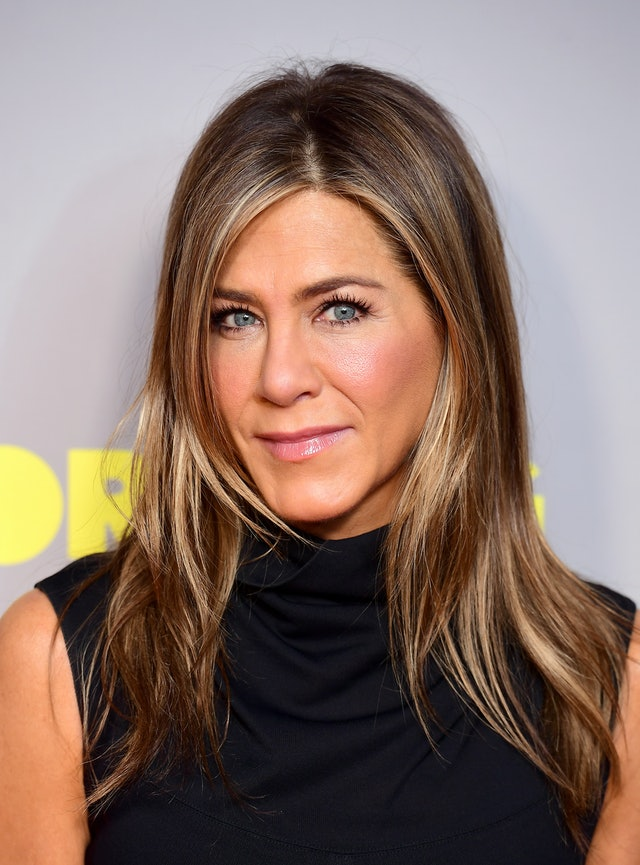 Aniston rocks a matching blush and lip gloss at a special screening.