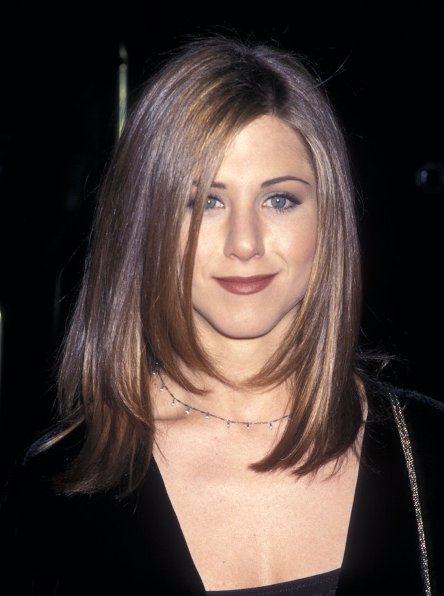 Aniston has tried out thin brows, gray shadow, and muted lipstick — all hallmarks of the '90s.
