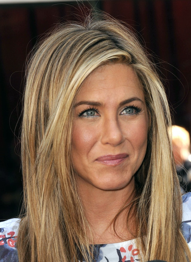 Aniston has tested out colorful eyeliner and lipstick at the same time.