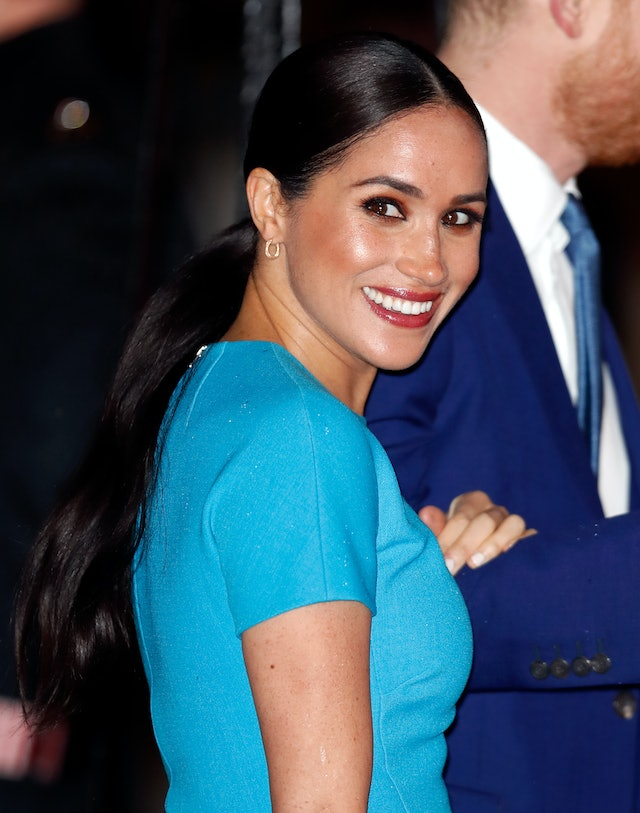 Markle wore a brown smoky eye and red lipstick to The Endeavour Fund Awards.