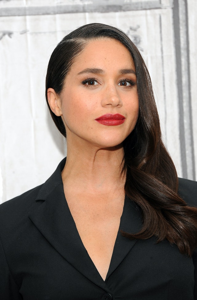 Markle's red lipstick was a chic and bold choice for the royal.