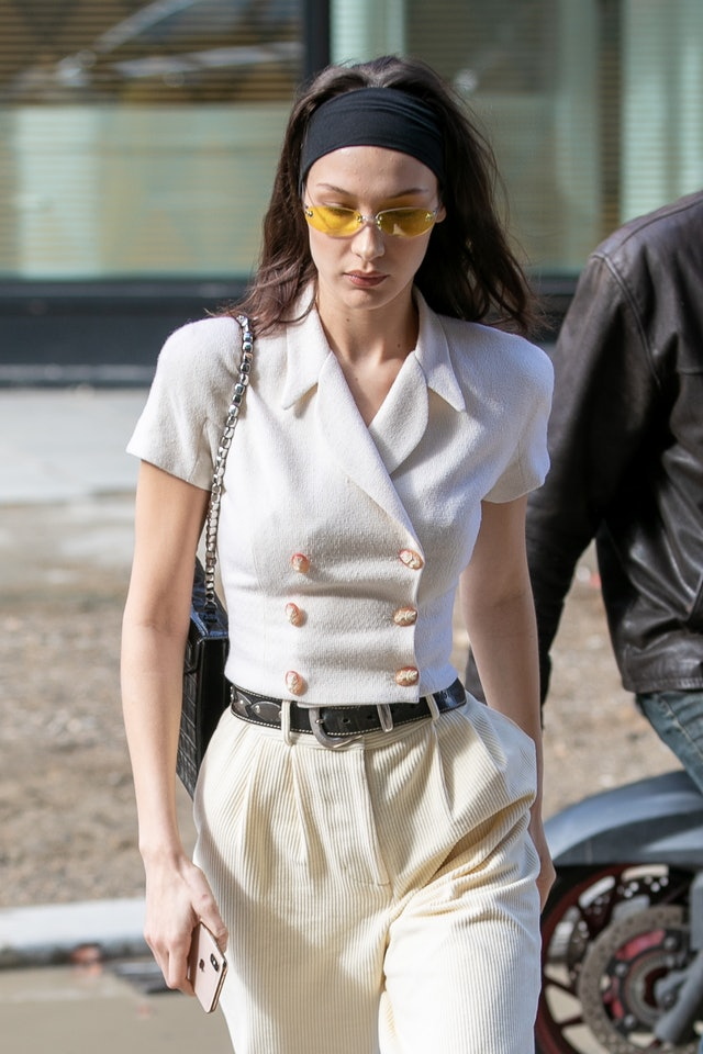 A sporty headband has been the final touch on Bella Hadid's street style looks lately