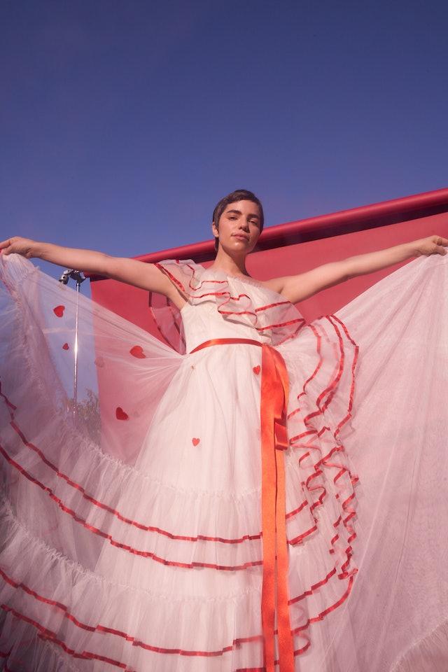 Angela Trimbur in a pink dress
