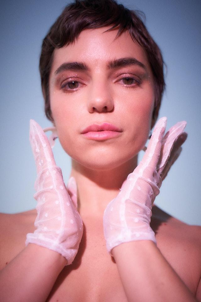 Angela Trimbur in white gloves