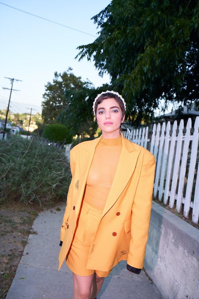 Angela Trimbur in yellow blazer