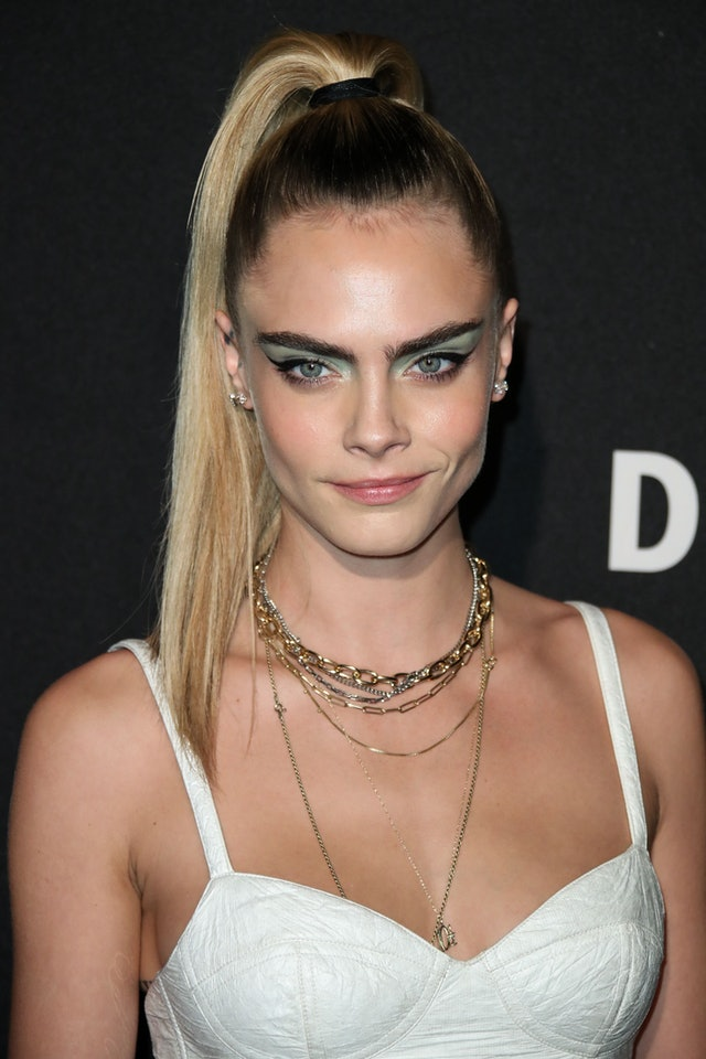 Cara Delevingne wore a minty version of this fall 2019 eyeshadow trend