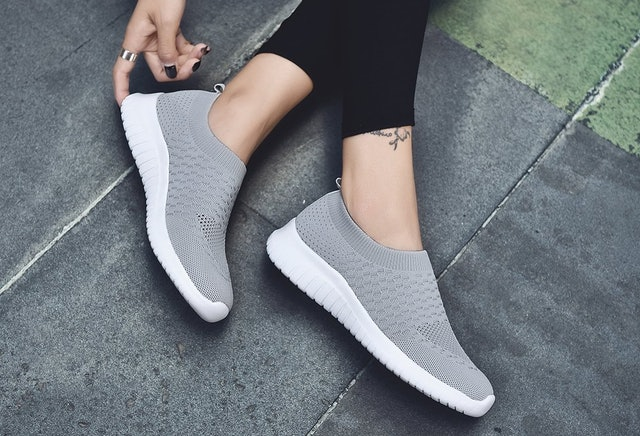 These popular slip-on shoes are made with a knit fabric that hugs your feet for a comfortable, snug fit.