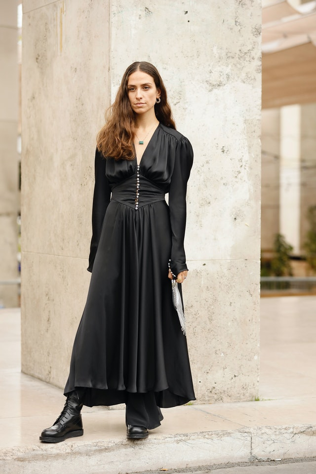 Street style photo of influencer Erika Boldrin wearing a black silk maxi dress and combat boots at Paris Fashion Week Spring 2020.