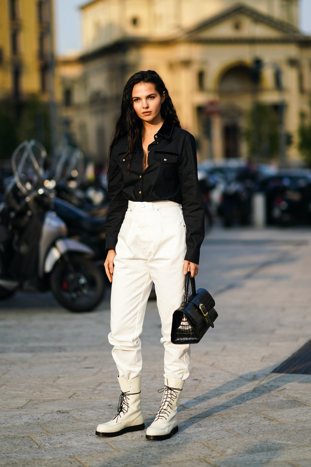 Street style photo of Doina Ciobanu wearing white combat boots during Milan Fashion Week Spring 2020.