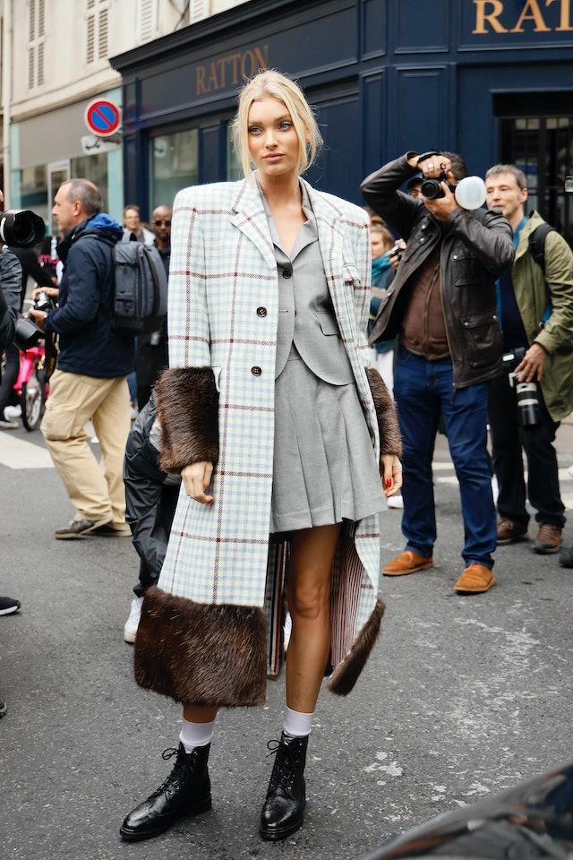 Street style photo of model Elsa Hosk outside Thom Browne show during Fashion Week.