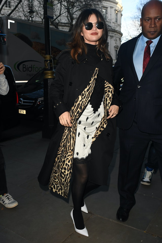 Selena Gomez's new bangs worn with slip dress and leopard trench