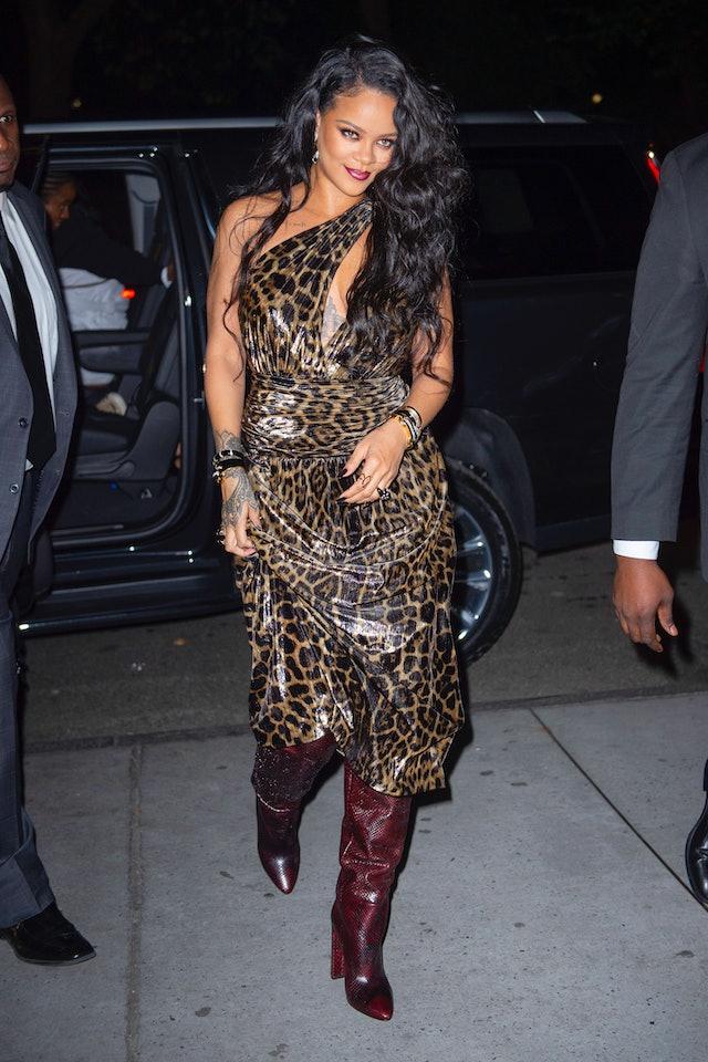 Rihanna wearing a leopard dress and snakeskin boots