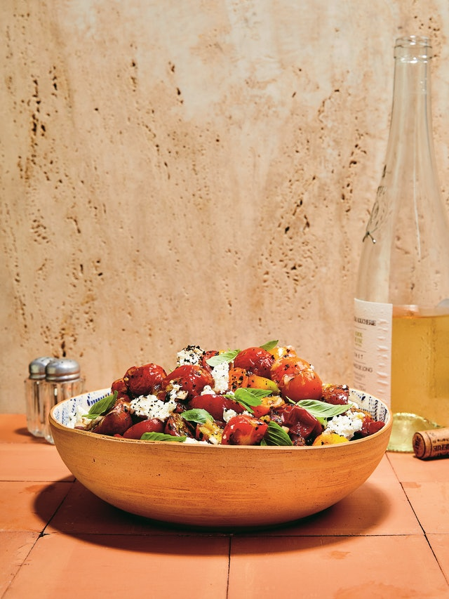 Combine roasted and fresh cherry tomatoes to create this warm salad recipe