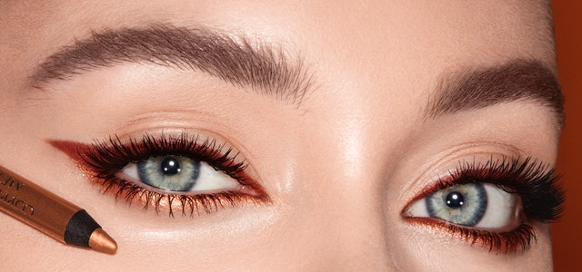 Woman with blue eyes and copper eyeliner