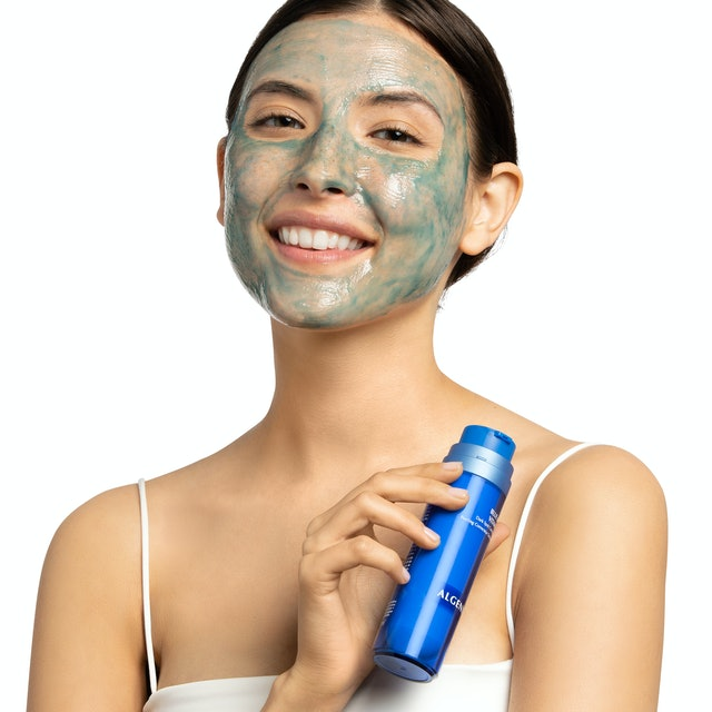 Algenist's Blue Algae Vitamin C Dark Spot Correcting Peel on model.