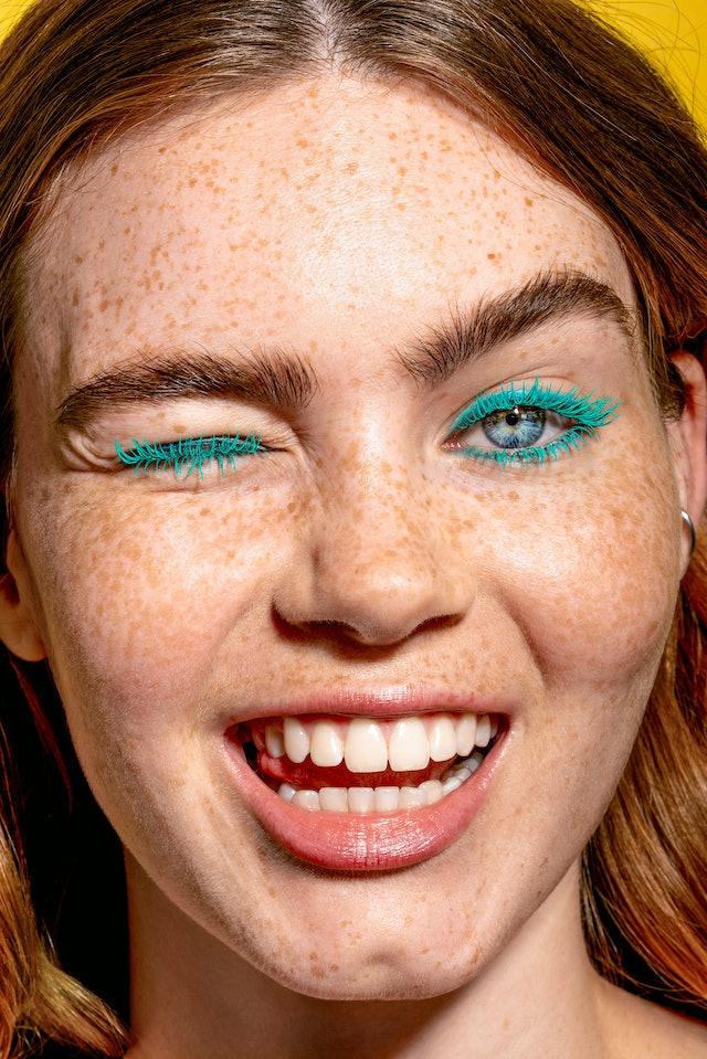 Blue teal mascara from the Ciaté London x SmileyWorld collaboration on model.
