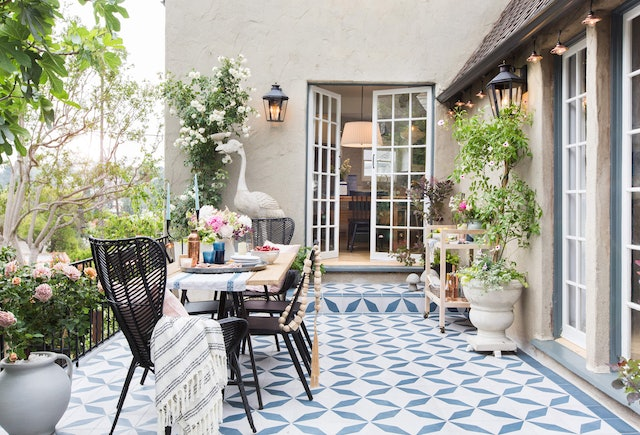 Pillows, throws, and lighting are all easy ways to refresh your patio for summer