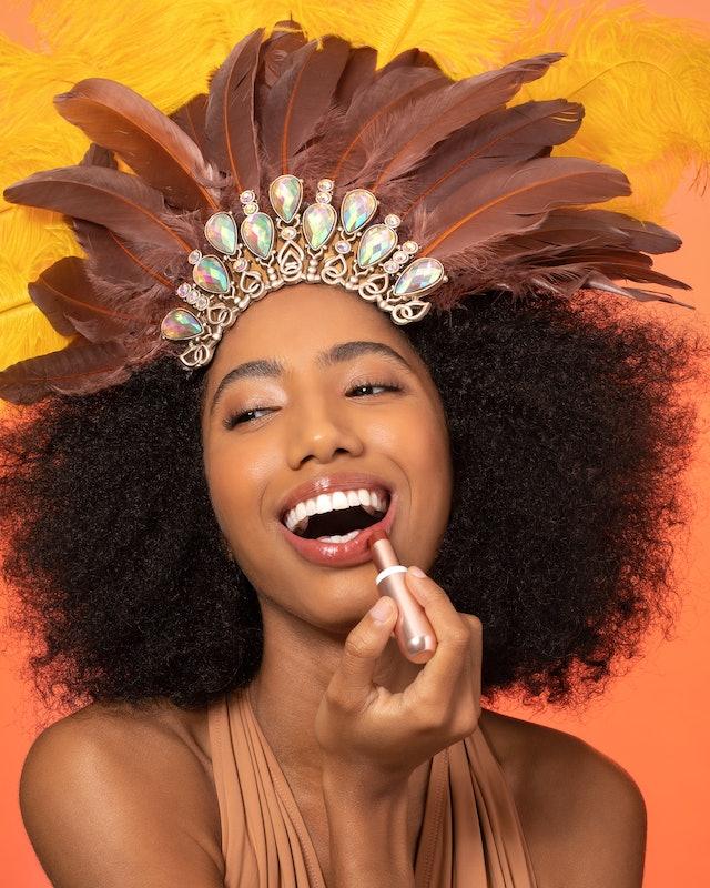 Sol de Janeiro's Brazilian Kiss Tinted Cupuaçu Lip Butter on model's lips.