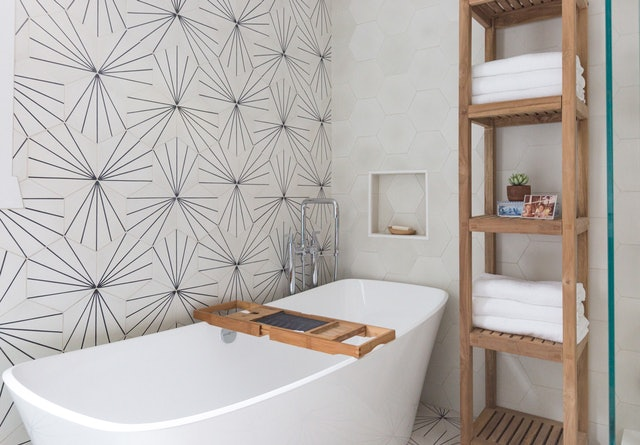 You can refresh your bathroom for summer by adding fresh towels, pretty soap dishes, and more