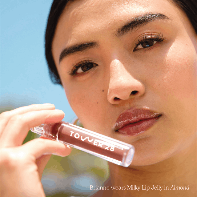 Tower 28's New ShineOn Milky Lip Jelly swatched on model.