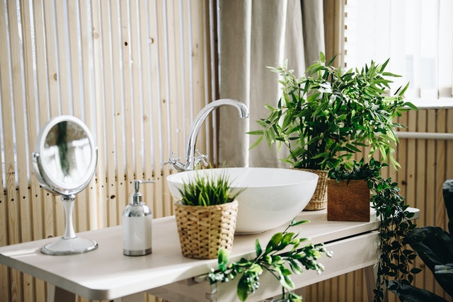 Modern potted evergreen artificial plants used in interior decoration