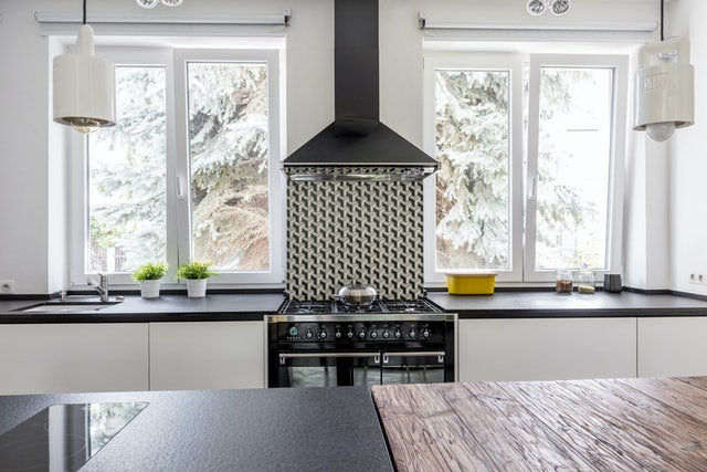 Black gas cooker and eave in a black and white modern kitchen