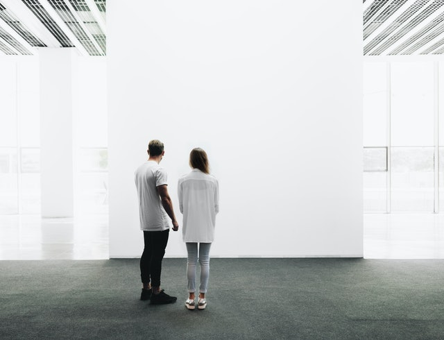 Man and woman walking through the gallery