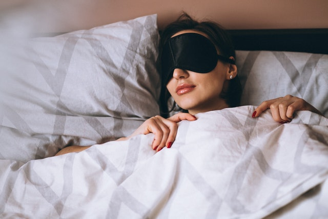 Woman with sleeping mask