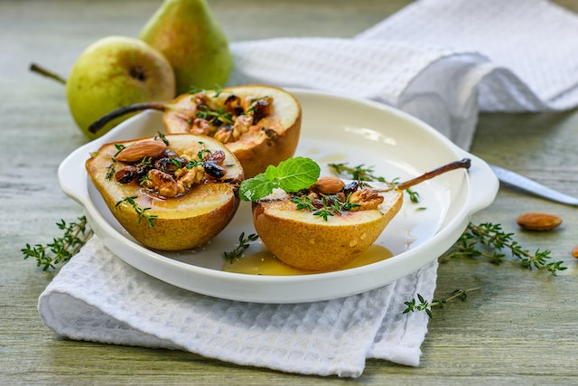 Baked pears with nuts (walnuts, almonds), honey and cinnamon.