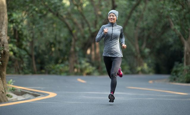 Woman running at winter park road