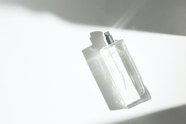 fashion luxury cosmetic aroma perfume bottle glass spray mockup product package with summer sun shadow light