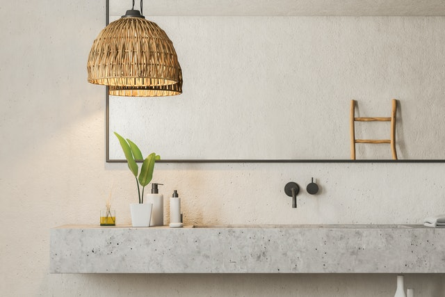 Close up of marble bathroom sink standing in room with white walls and big horizontal mirror hanging above it. 3d rendering