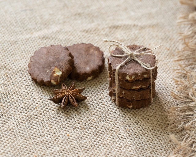 chocolate cookies with anise on burlap